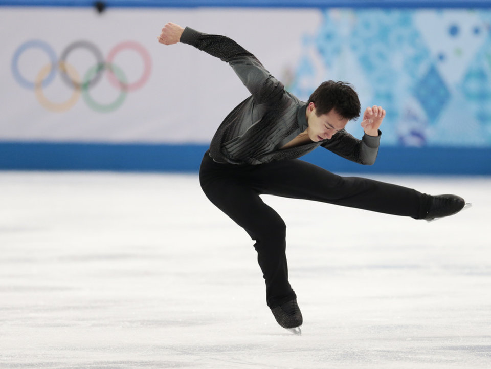 Photo - Patrick Chan of Canada competes in the men's team short program figure skating competition at the Iceberg Skating Palace during the 2014 Winter Olympics, Thursday, Feb. 6, 2014, in Sochi, Russia. (AP Photo/Ivan Sekretarev)