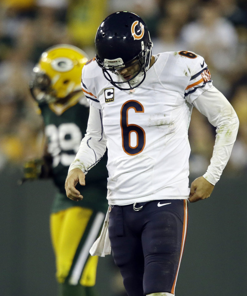 Photo -   Chicago Bears' Jay Cutler walks off the field after being sacked during the second half of an NFL football game against the Green Bay Packers Thursday, Sept. 13, 2012, in Green Bay, Wis. The Packers won 23-10. (AP Photo/Jeffrey Phelps)