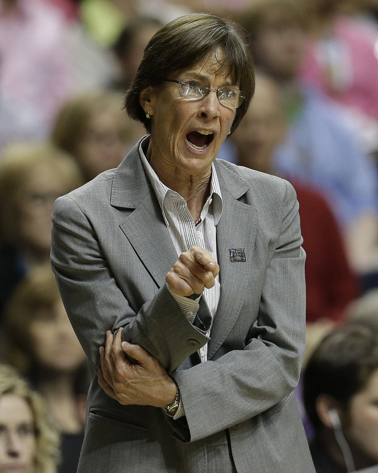 Photo - Stanford head coach Tara VanDerveer calls a play against Connecticut during the second half of the semifinal game in the Final Four of the NCAA women's college basketball tournament, Sunday, April 6, 2014, in Nashville, Tenn. (AP Photo/Mark Humphrey)