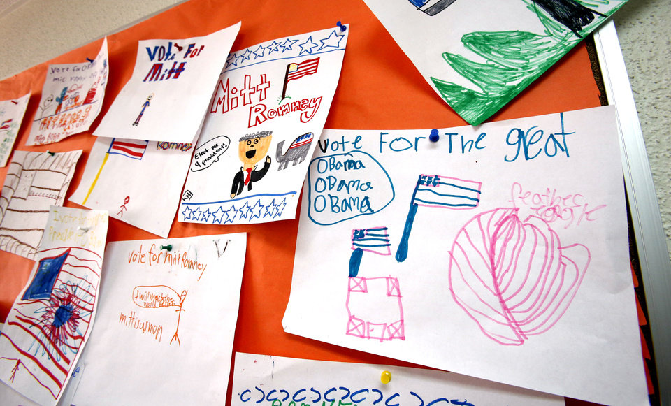 Posters created by kids are on display on a bulletin board during the YMCA kids election at Greenbriar Program Center on Tuesday, Oct. 30, 2012 in Oklahoma City, Okla. Photo by Steve Sisney, The Oklahoman