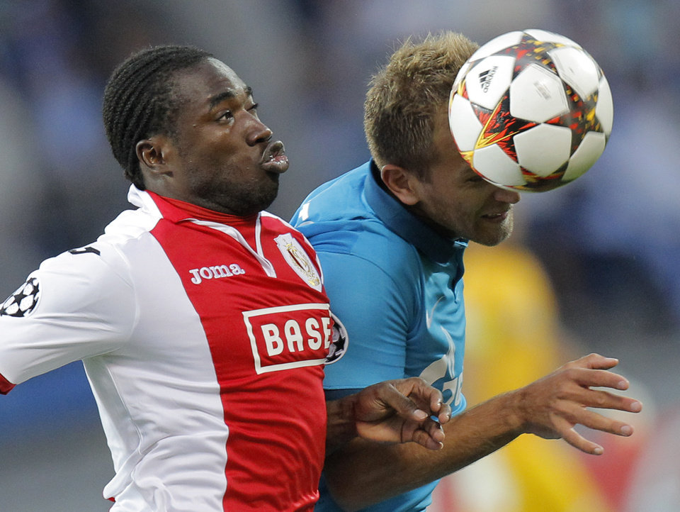 Photo - Standard's de Liege Jeff Louis, left, fights for the ball with Zenit's Domenico Criscito during the UEFA Champions League, play offs, 2nd leg soccer match, between Standard de Liege  and Zenit St. Petersburg in St.Petersburg, Russia, Tuesday, Aug. 26, 2014. (AP Photo/Dmitry Lovetsky)