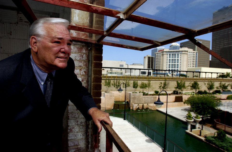 Photo - Oklahoma City, OK, June 12, 2003:  Jim Brewer, Bricktown developer, peers out of the unfinished second floor of one of his properties overlooking the Bricktown Canal.  Staff Photo by Steve Sisney