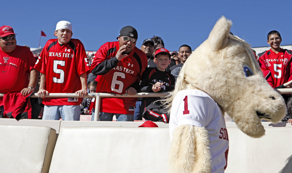Photo - Texas Tech fans yell at OU mascot Sooner during the college football game between the University of Oklahoma Sooners (OU) and Texas Tech University Red Raiders (TTU ) at Jones AT&T Stadium in Lubbock, Texas, Saturday, Nov. 21, 2009. Photo by Bryan Terry, The Oklahoman
