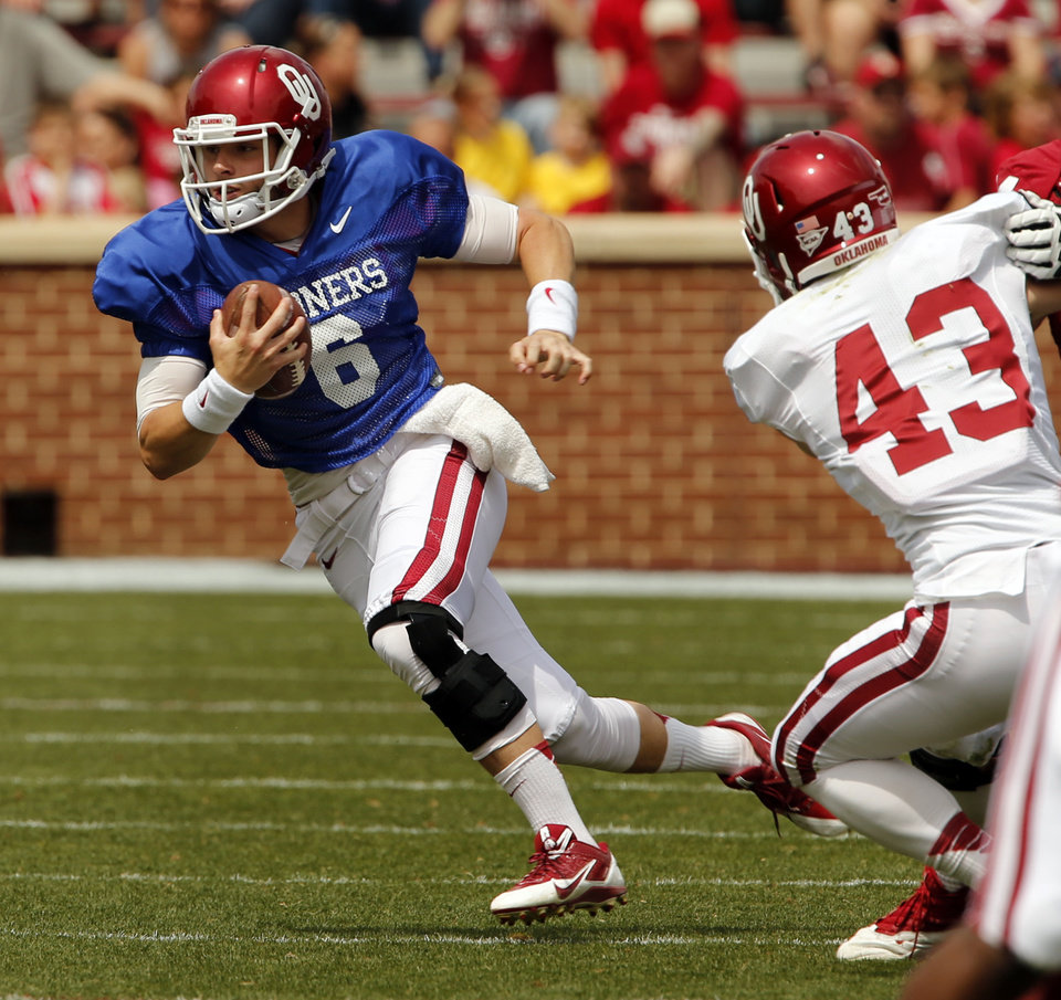 Photo - Baker Mayfield carries during the Spring College Football Game of the University of Oklahoma Sooners (OU) at Gaylord Family-Oklahoma Memorial Stadium in Norman, Okla., on Saturday, April 12, 2014.  Photo by Steve Sisney, The Oklahoman