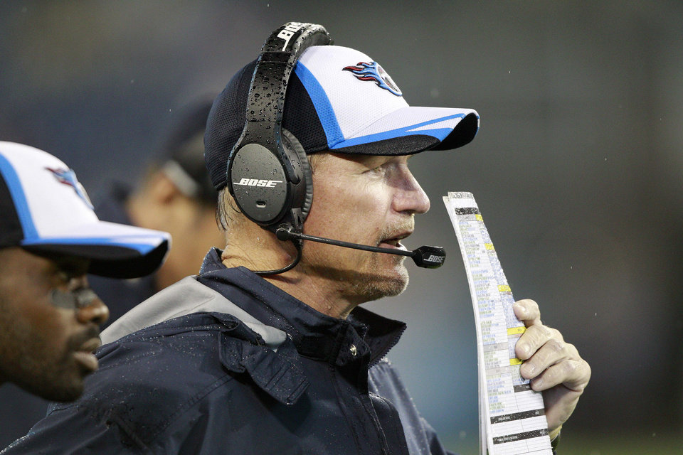 Photo - Tennessee Titans head coach Ken Whisenhunt watches the action against the Green Bay Packers during his first game as the Titans' head coach in the fourth quarter of a preseason NFL football game Saturday, Aug. 9, 2014, in Nashville, Tenn. (AP Photo/Wade Payne)