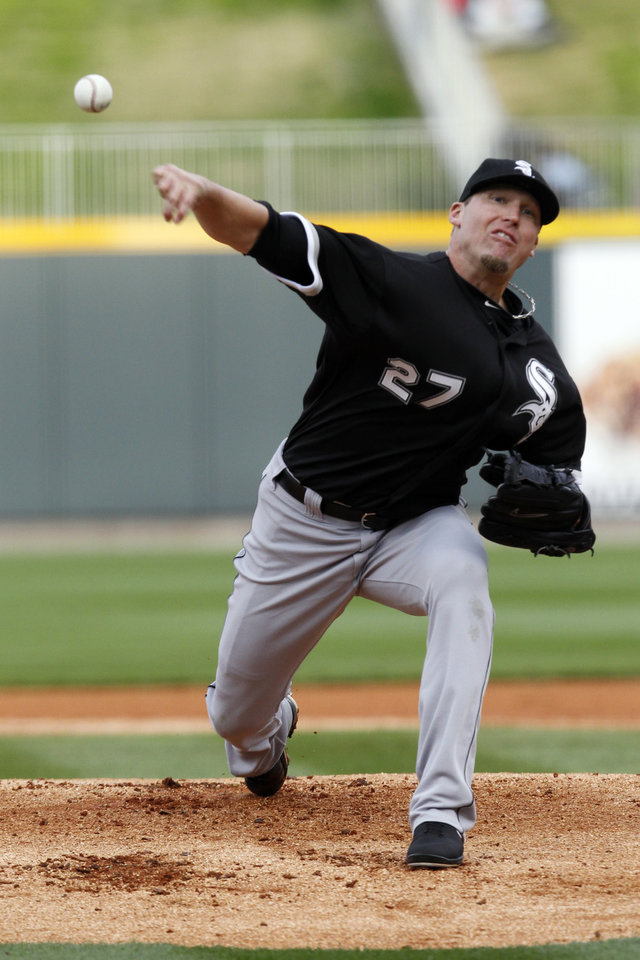 Photo - Chicago White Sox pitcher Matt Lindstrom throws during a spring exhibition baseball game against the Birmingham Barons on Friday, March 28, 2014, in Birmingham, Ala. (AP Photo/Butch Dill)