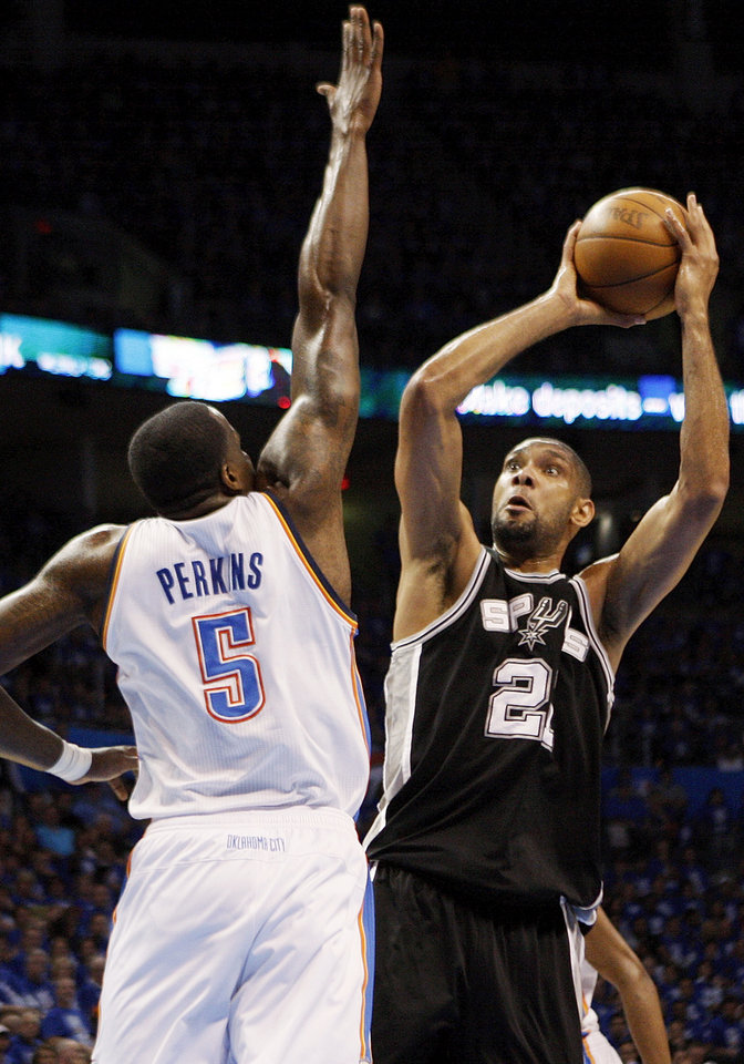 San Antonio's Tim Duncan (21) shoots against Oklahoma City's Kendrick Perkins (5) during Game 3 of the Western Conference Finals between the Oklahoma City Thunder and the San Antonio Spurs in the NBA playoffs at the Chesapeake Energy Arena in Oklahoma City, Thursday, May 31, 2012.  Photo by Nate Billings, The Oklahoman