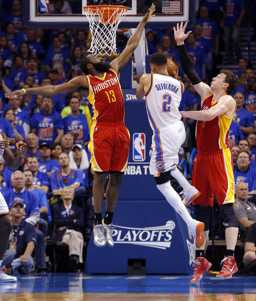 Oklahoma City\'s Thabo Sefolosha (2) tries to drive to the basket as Houston\'s James Harden (13) and Omer Asik (3) during Game 5 in the first round of the NBA playoffs between the Oklahoma City Thunder and the Houston Rockets at Chesapeake Energy Arena in Oklahoma City, Wednesday, May 1, 2013. Photo by Sarah Phipps, The Oklahoman