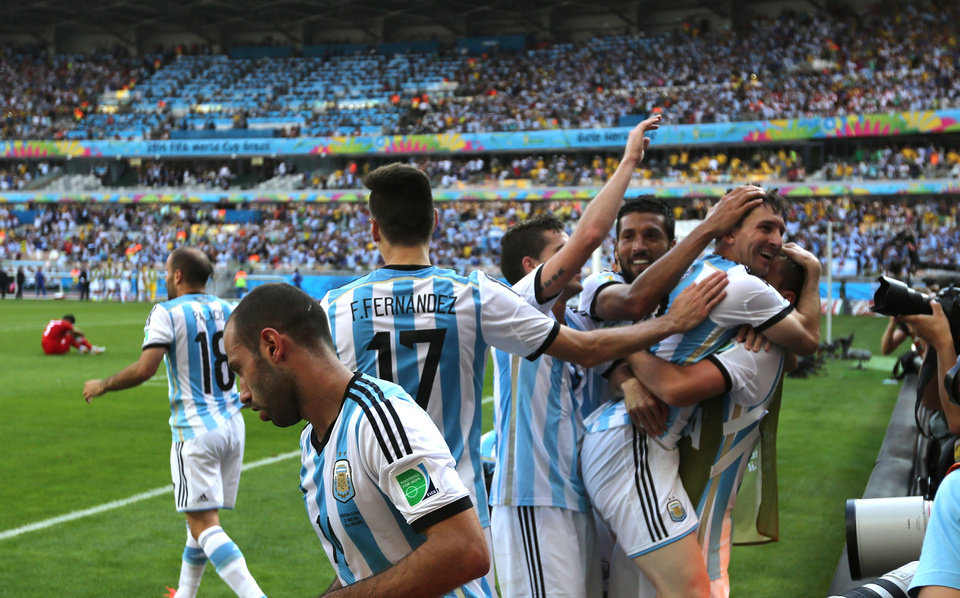 Photo - Argentina's Lionel Messi, second right, celebrates after scoring during the group F World Cup soccer match between Argentina and Iran at the Mineirao Stadium in Belo Horizonte, Brazil, Saturday, June 21, 2014. Argentina won 1-0. (AP Photo/Jon Super)