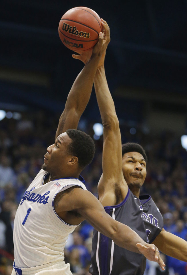 Photo - Kansas guard Wayne Selden Jr., left, is fouled by TCU center Karviar Shepherd, right, during the first half of an NCAA college basketball game in Lawrence, Kan., Saturday, Feb. 15, 2014. (AP Photo/Orlin Wagner)