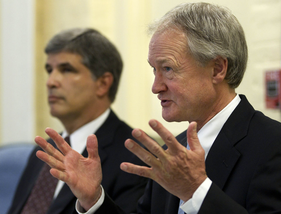 Photo -   Rhode Island Gov. Lincoln Chafee, right, faces reporters following a closed-door session of the state's Economic Development Corp. board Wednesday, May 16, 2012, in Providence, R.I., as EDC legal counsel David Gilden looks on at left. Former Red Sox pitcher Curt Schilling is asking Rhode Island for additional help to save his video game company, prompting state leaders to consider whether the firm is viable enough to justify the investment. (AP Photo/Steven Senne)