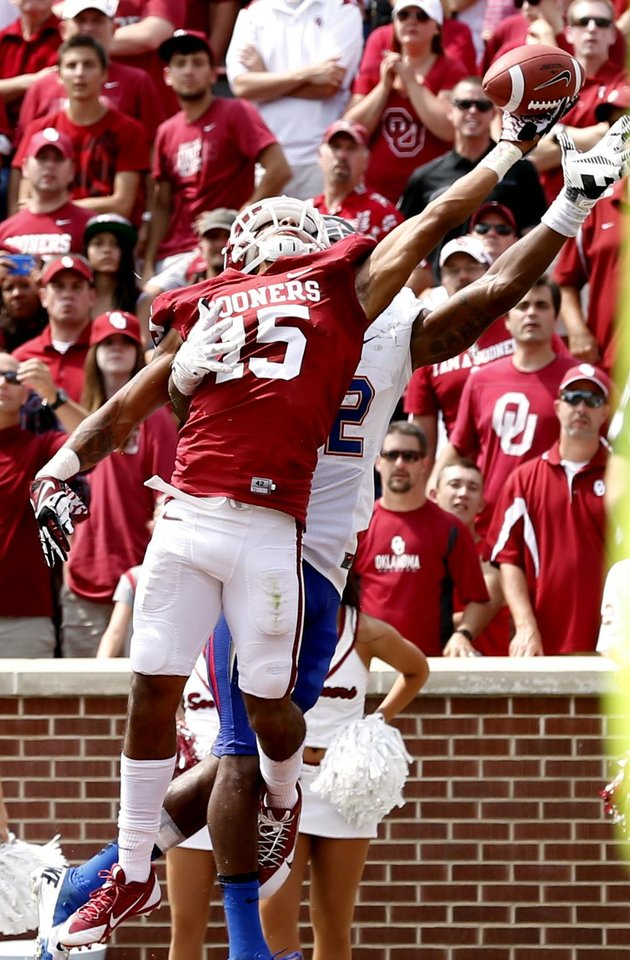 Photo - Zack Sanchez (15) deflects a pass in the end zone intended for Tulsa's Jordan James (12) during the second half of a college football game between the University of Oklahoma Sooners (OU) and the Tulsa Golden Hurricane (TU) at Gaylord Family-Oklahoma Memorial Stadium in Norman, Okla., on Saturday, Sept. 14, 2013. Photo by Steve Sisney, The Oklahoman