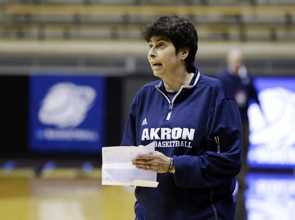 Photo - Akron head coach Jodi Kest yells to her team during during practice at the NCAA women's college basketball tournament in West Lafayette, Ind., Friday, March 21, 2014.  Akron plays Purdue in a first-round game on Saturday. (AP Photo/Michael Conroy)