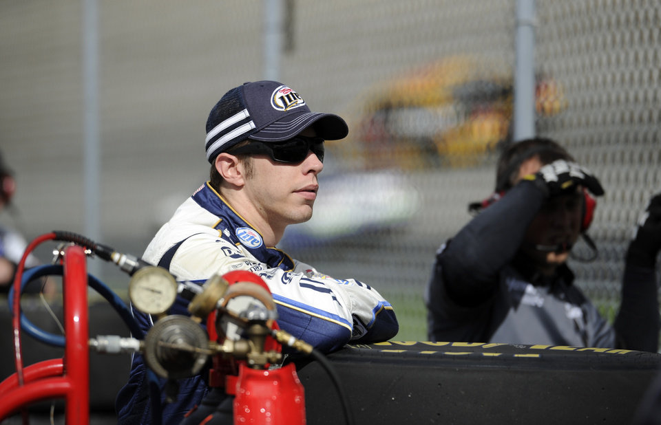 Photo - Brad Keselowski watches practice for Sunday's NASCAR Sprint Cup series auto race, Saturday, Sept. 28, 2013, at Dover International Speedway in Dover, Del. (AP Photo/Nick Wass)