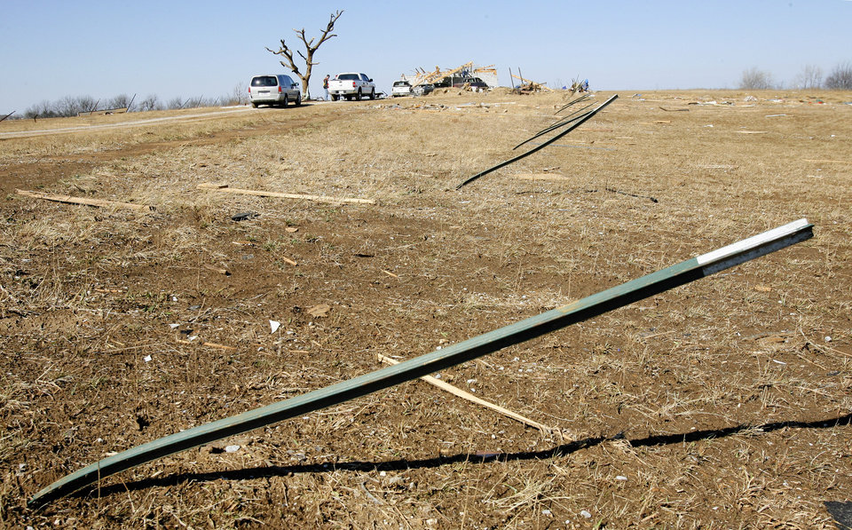 Bent fence t-posts in a field on Brock Road in Lone Grove, Wednesday, Feb. 11, 2009. BY PAUL B. SOUTHERLAND, THE OKLAHOMAN