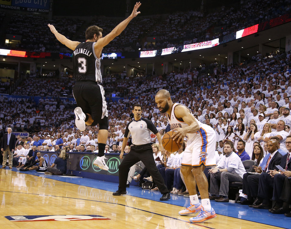 Photo - San Antonio's Marco Belinelli (3) leaps past Oklahoma City's Derek Fisher (6) as he sets up to shoot a 3-pointer during Game 6 of the Western Conference Finals in the NBA playoffs between the Oklahoma City Thunder and the San Antonio Spurs at Chesapeake Energy Arena in Oklahoma City, Saturday, May 31, 2014. Oklahoma City lost 112-107. Photo by Bryan Terry, The Oklahoman