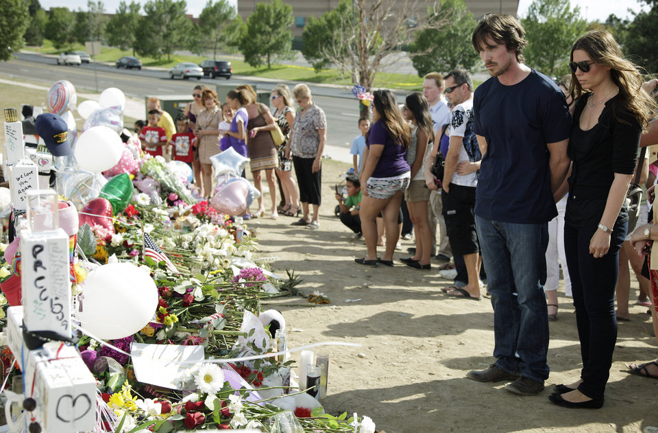Photo -   Actor Christian Bale and his wife Sibi Blazic visit a memorial to the victims of Friday's mass shooting, Tuesday, July 24, 2012, in Aurora, Colo. Twelve people were killed when a gunman opened fire during a late-night showing of the movie