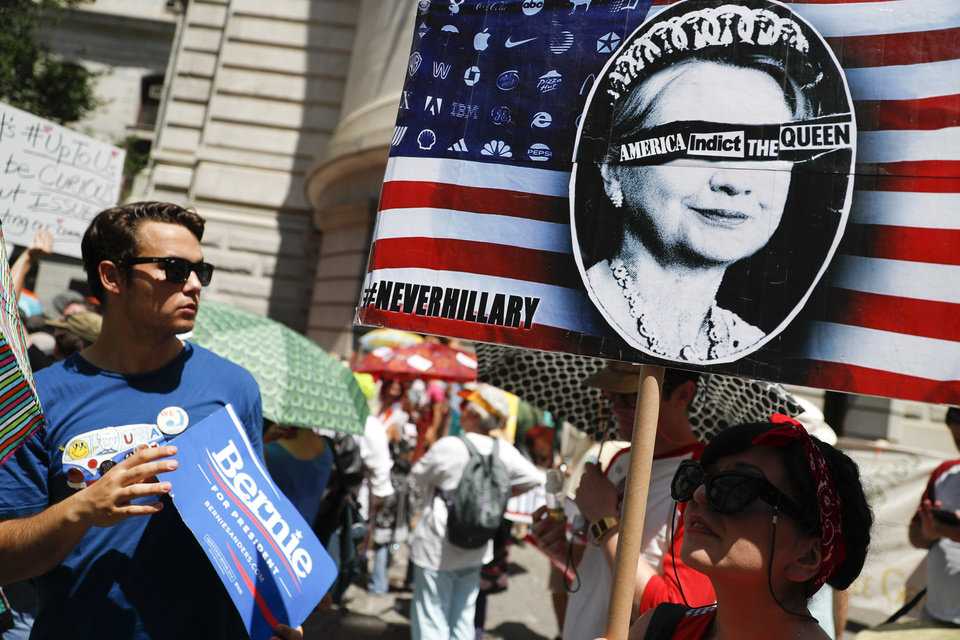 Photo - Supporters of Sen. Bernie Sanders, I-Vt., arrive for a demonstration at Dillworth Park on Sunday, July 24, 2016, in Philadelphia. The Democratic National Convention starts Monday in Philadelphia. (AP Photo/John Minchillo)