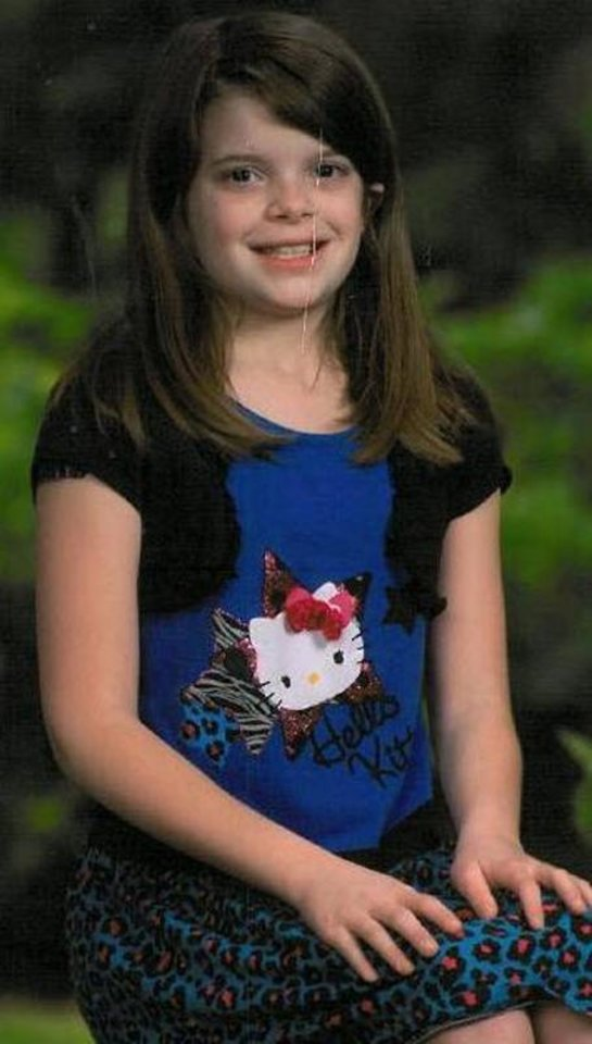 Photo - This undated photo provided by Kansas Bureau of Investigation shows 10-year-old Hailey Owens. Craig Michael Wood was charged Wednesday, Feb. 19, 2014, with first-degree murder in the death of a 10-year-old girl. A body believed to be that of Hailey Owens was found Wednesday at the home owned by Wood, Police Chief Paul Williams said at a news conference. Official confirmation won't occur until after an autopsy, but Police Chief Paul Williams said