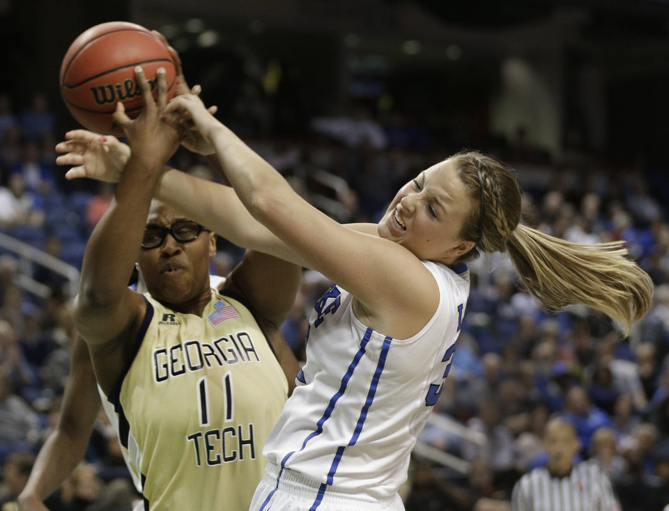 Photo - Duke's Tricia Liston, right, battles Georgia Tech's Nariah Taylor, left, for a rebound during the second half of an NCAA college basketball game at the Atlantic Coast Conference tournament in Greensboro, N.C., Friday, March 7, 2014. Duke won 82-52. (AP Photo/Chuck Burton)