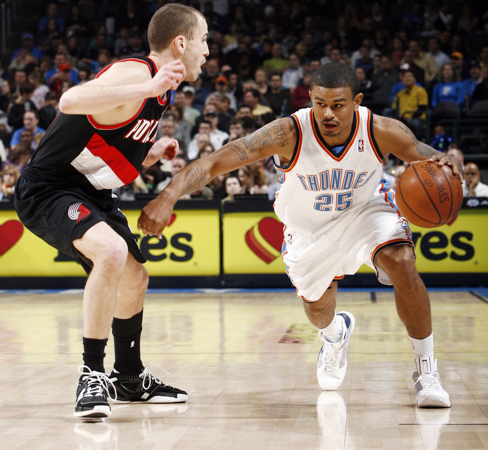 Photo - Oklahoma City's Earl Watson (25) dribbles next to Sergio Rodriguez (11) of Portland during the NBA basketball game between the Oklahoma City Thunder and the Portland Trail Blazers at the Ford Center in Oklahoma City, Friday, February 6, 2009. BY NATE BILLINGS, THE OKLAHOMAN ORG XMIT: KOD