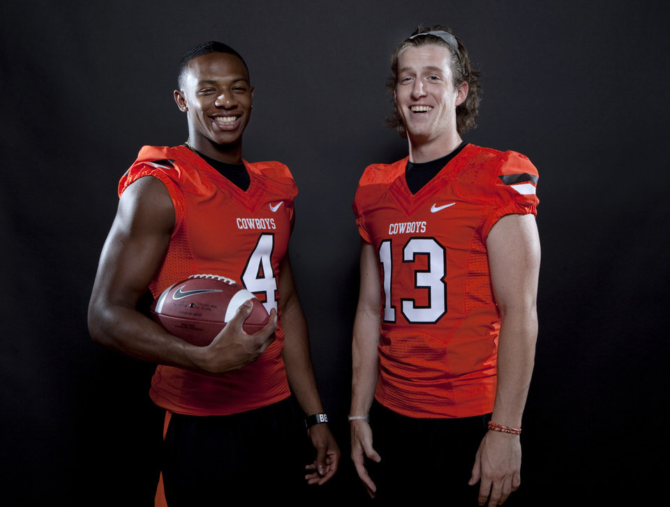 Oklahoma State\'s Justin Gilbert (4) and Quin Sharp (13) pose for a photoduring Oklahoma State\'s Football media day at in Stillwater, Okla., Saturday, Aug. 6, 2011. Photo by Sarah Phipps, The Oklahoman