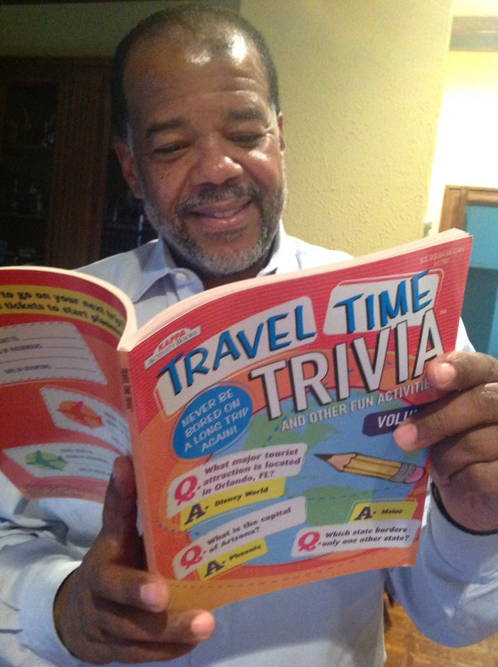 Photo - Hubby takes checks out the Trivia Book which came in the pack.