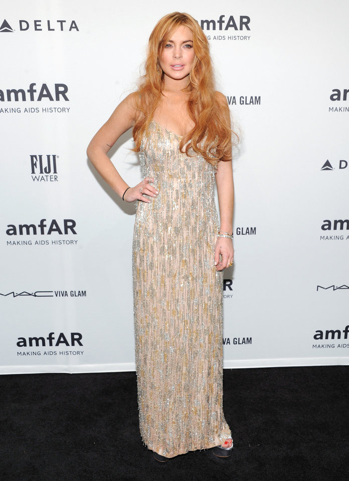 Photo - FILE - In this Feb. 6, 2013 file photo, actress Lindsay Lohan attends amfAR's New York gala at Cipriani Wall Street in New York.  Lohan is due back in court on Monday March 18, 2013 for a hearing that will lay out when her trial will begin on misdemeanor charges she lied to police and was driving recklessly when her sports car crashed in June 2012. Lohan's trial is scheduled to begin this week, but her attorney has previously sought a delay. (Photo by Evan Agostini/Invision/AP, File)