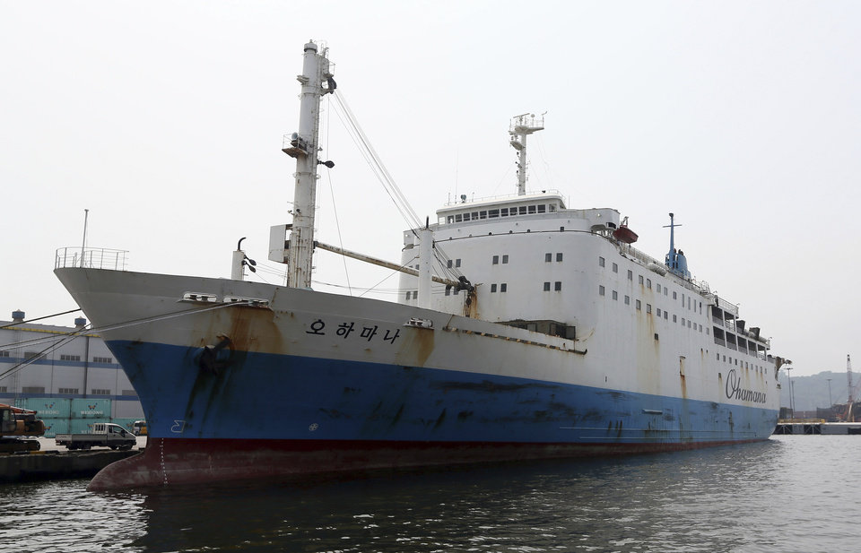 Photo - In this June 19, 2014 photo, Ohamana, a Chonghaejin Marine Co., car ferry that plied the same route as the sunken Sewol, drops anchor at Incehon port, South Korea. The company that operated the doomed South Korean ferry that sank in April had a questionable safety record throughout its history, marred by frequent maritime accidents followed by sanctions from authorities. Chonghaejin Marine Co. sailors or upper-level managers were found to be the primary cause of at least five crashes between 2003 and this year. (AP Photo/Yonhap)  KOREA OUT
