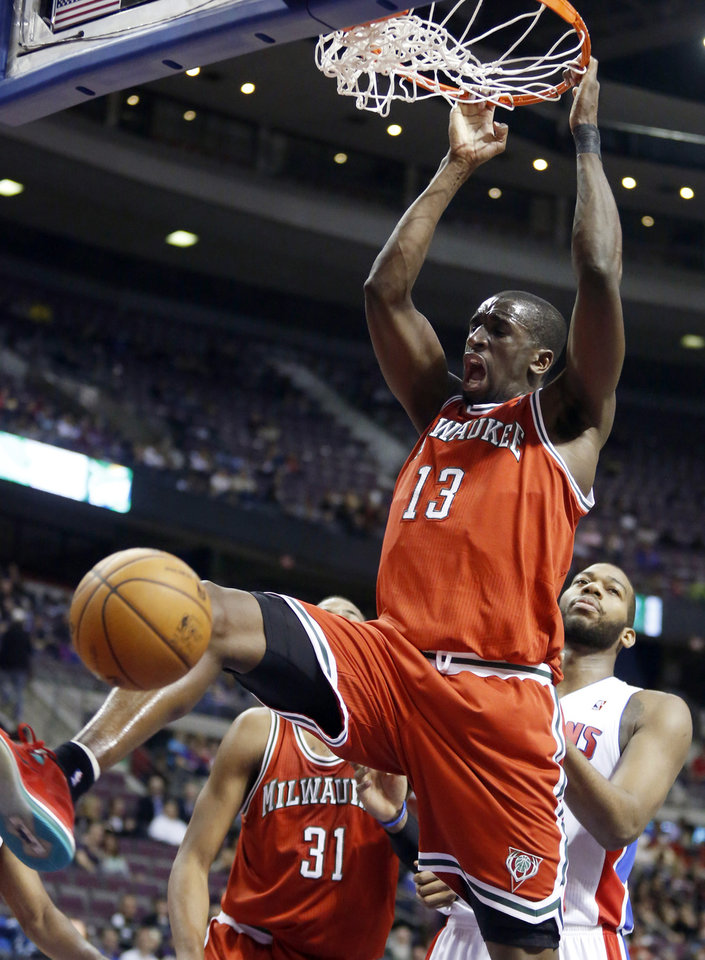 Milwaukee Bucks center Ekpe Udoh (13) dunks after going past Detroit Pistons center Greg Monroe, right, in the first half of an NBA basketball game Tuesday, Jan. 29, 2013, in Auburn Hills, Mich. (AP Photo/Duane Burleson)