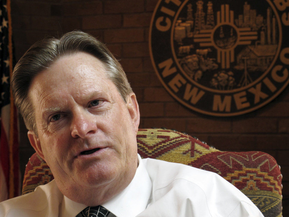 Photo - In this April 10, 2014, image, Hobbs, New Mexico, Mayor Sam Cobb talks about the challenges the city has had in luring housing developers to meet the population demands from the Permian Basin oil boom, in Hobbs, N.M. (AP Photo.Jeri Clausing)