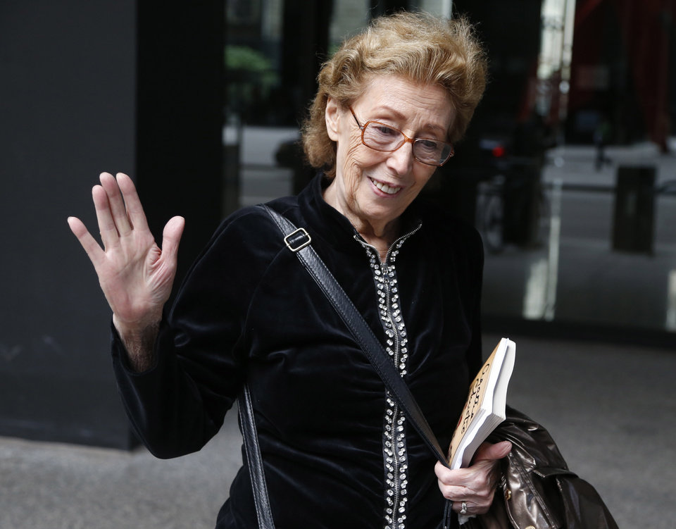 Photo - Jacqueline Goldberg departs federal court after a federal jury returned with a finding in Donald Trump's favor in her civil case alleging that the real estate mogul cheated her in a skyscraper condo deal, Thursday, May 23, 2013 in Chicago. (AP Photo/Charles Rex Arbogast)