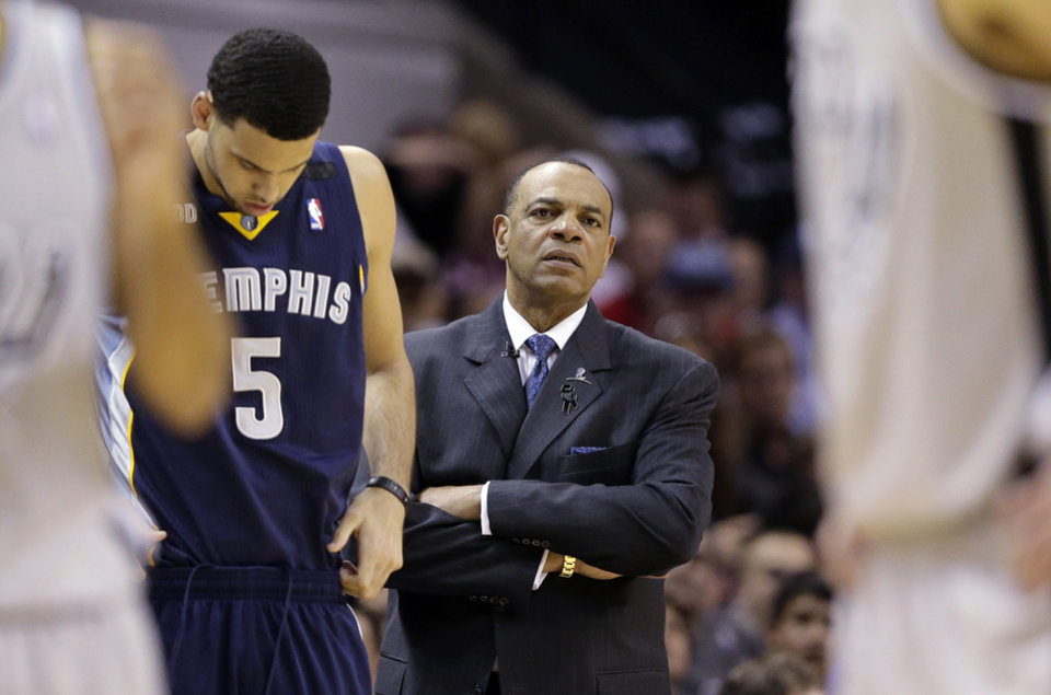 Photo - Memphis Grizzlies coach Lionel Hollins, center, watches play during the second half in Game 1 of a Western Conference Finals NBA basketball playoff series against the San Antonio Spurs, Sunday, May 19, 2013, in San Antonio. San Antonio won 105-83.  (AP Photo/Eric Gay)
