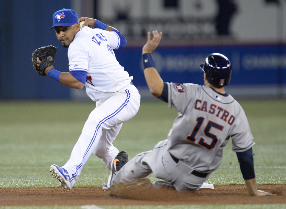 Photo - Houston Astros' Jason Castro slides into second after being forced out as Toronto Blue Jays' Maicer Izturis looks toward first base during the fourth inning of a baseball game in Toronto on Thursday, April 10, 2014. Jose Altuve was safe at first. (AP Photo/The Canadian Press, Frank Gunn)