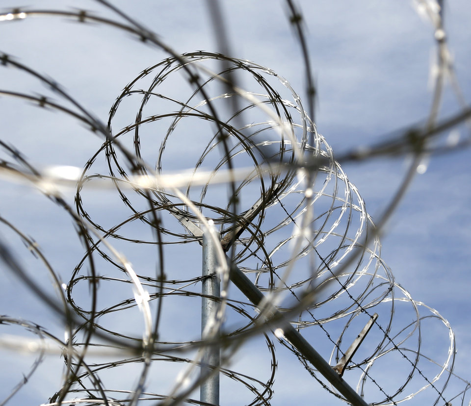 Photo - Razor wire on a fence at the North Fork Correctional Center in Sayre, Okla., Thursday, June 23, 2016. Photo by Kurt Steiss, The Oklahoman