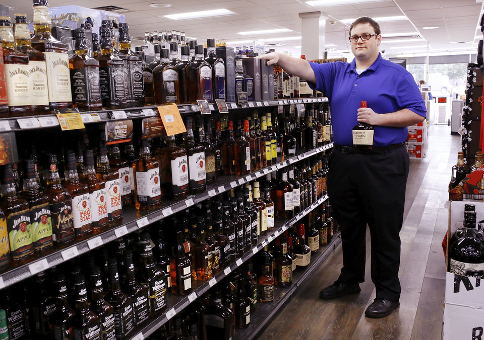 Photo -  Blake Cody is the manager of Byron's Liquor Warehouse in Oklahoma City. [Photo by Jim Beckel, The Oklahoman]