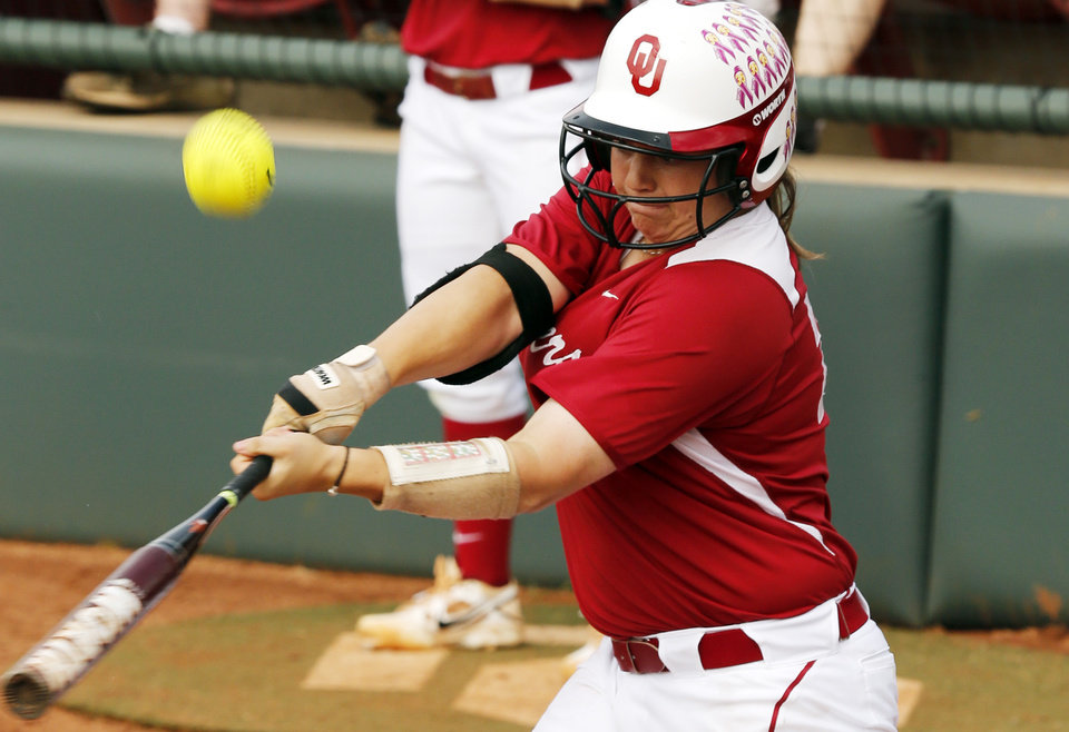 Photo - Oklahoma's Brittany Williams hits as the University of Oklahoma Sooner (OU) softball team plays Tennessee in game two of the NCAA super regional at Marita Hynes Field on May 24, 2014 in Norman, Okla. Photo by Steve Sisney, The Oklahoman