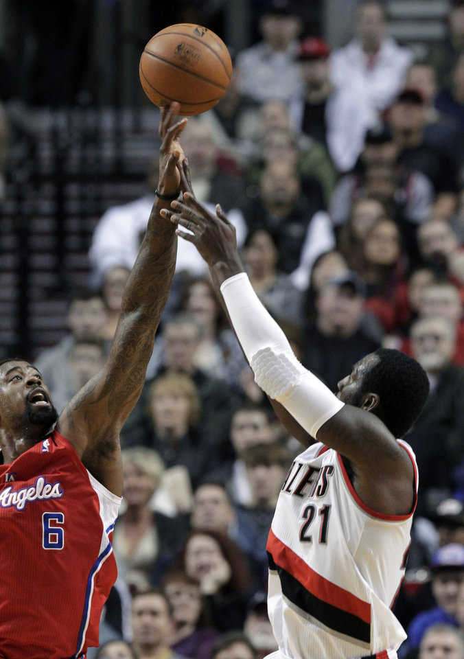 Photo - Los Angeles Clippers center DeAndre Jordan, left, blocks a shot by Portland Trail Blazers center J.J. Hickson during the first quarter of an NBA basketball game in Portland, Ore., Saturday, Jan. 26, 2013. (AP Photo/Don Ryan)