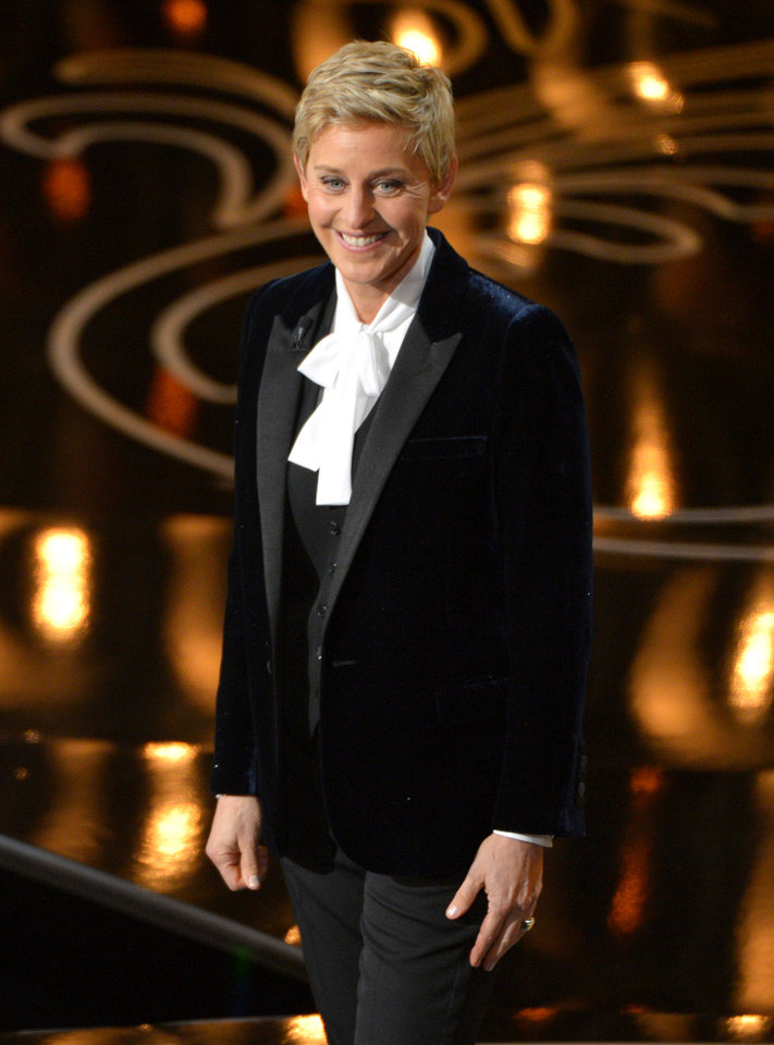 Photo - Ellen DeGeneres hosts the Oscars at the Dolby Theatre on Sunday, March 2, 2014, in Los Angeles.  (Photo by John Shearer/Invision/AP)