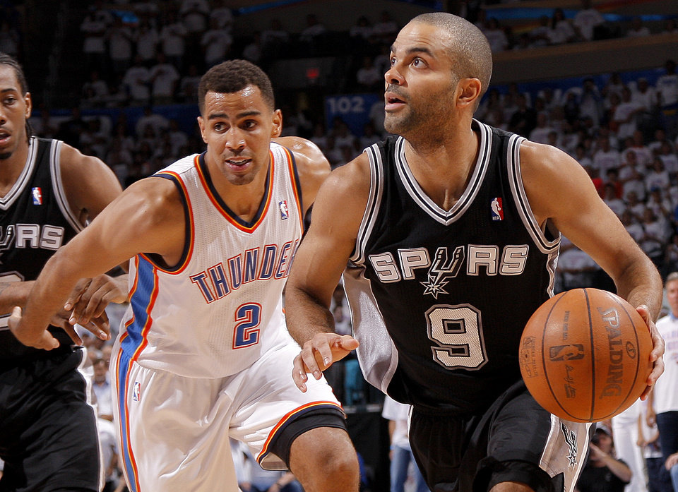 San Antonio's Tony Parker (9) goes past Oklahoma City's Thabo Sefolosha (2) during Game 6 of the Western Conference Finals between the Oklahoma City Thunder and the San Antonio Spurs in the NBA playoffs at the Chesapeake Energy Arena in Oklahoma City, Wednesday, June 6, 2012. Photo by Bryan Terry, The Oklahoman