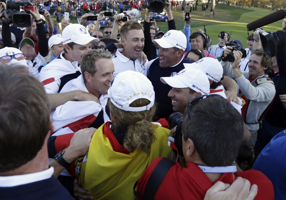 Photo - European players celebrate after winning the Ryder Cup PGA golf tournament Sunday, Sept. 30, 2012, at the Medinah Country Club in Medinah, Ill. (AP Photo/David J. Phillip)  ORG XMIT: PGA233