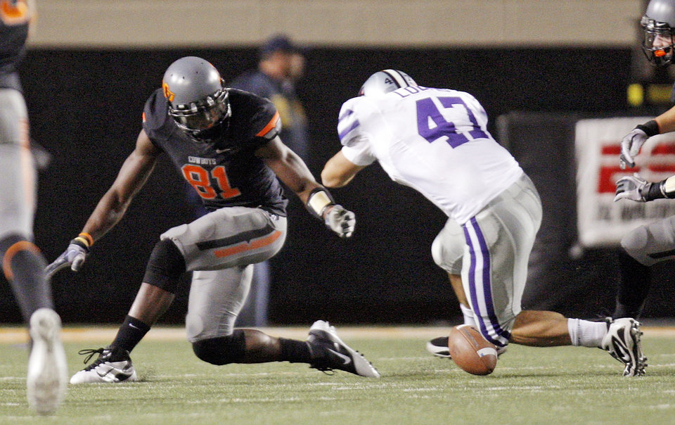 Photo - OSU's Justin Blackmon (81) fumbles a punt return near Jared Loomis (47) of KSU in the first quarter during a college football game between the Oklahoma State University Cowboys (OSU) and the Kansas State University Wildcats (KSU) at Boone Pickens Stadium in Stillwater, Okla., Saturday, Nov. 5, 2011. Kansas State recovered the fumble. Photo by Nate Billings, The Oklahoman
