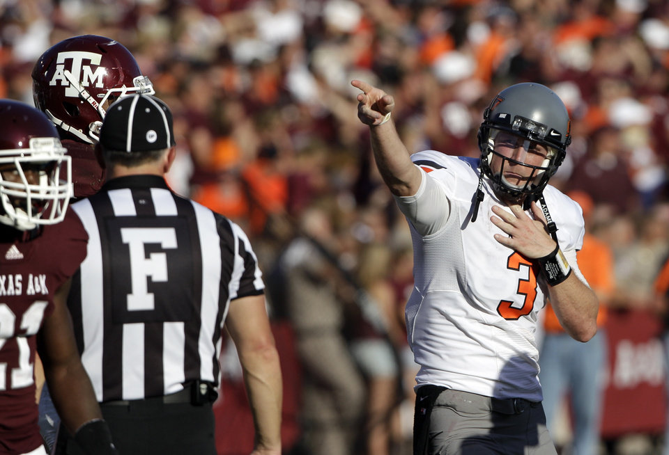 Oklahoma State quarterback Brandon Weeden (3) signals a first down after a penalty call against Texas A&M during the fourth quarter of an NCAA college football game Saturday, Sept. 24, 2011, in College Station, Texas. Oklahoma State beat Texas A&M 30-29. (AP Photo/David J. Phillip) ORG XMIT: TXDP124