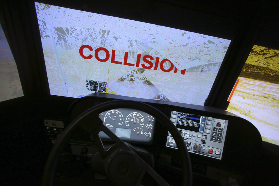 A screen shows a collision during a North Texas Tollway Authority training class in Plano, Texas, Thursday, Nov. 15, 2012.  The NTTA is using the computer generated simulator to help snowplow operators become better at handling slick roads in a region not used to ice and snow. Highway officials in at least nine states are using the sophisticated simulator to give plow drivers a chance to practice snow removal in any weather. It works like a video game, recreating slick pavement, poor visibility and even children or animals bolting across the road.(AP Photo/LM Otero)