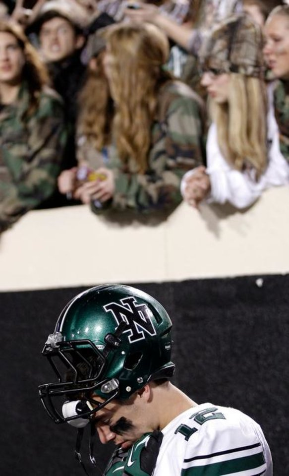 Photo - Norman North's Jake Higginbotham (12) reacts in the closing seconds of the loss to Jenks during the Class 6A Oklahoma state championship football game between Norman North High School and Jenks High School at Boone Pickens Stadium on Friday, Nov. 30, 2012, in Stillwater, Okla.   Photo by Chris Landsberger, The Oklahoman