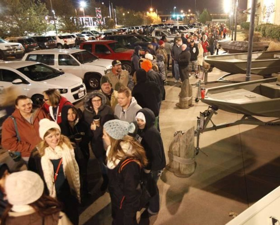 Photo - A long line of customers waits for the opening of Bass Pro Shop's Black Friday sale in Oklahoma City, OK, Friday, November 29, 2013, Photo by Paul Hellstern, The Oklahoman