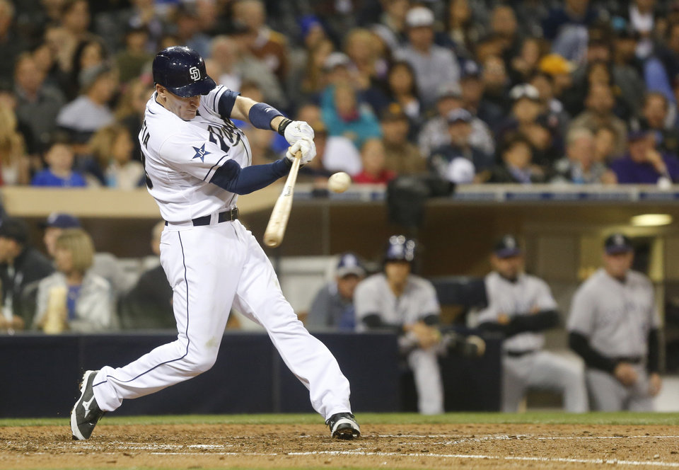 Photo - San Diego Padres' Chris Denorfia rips a double down the right field line that drives in a run against the Colorado Rockies in the fifth inning of a baseball game Wednesday, April 16, 2014, in San Diego.  (AP Photo/Lenny Ignelzi)