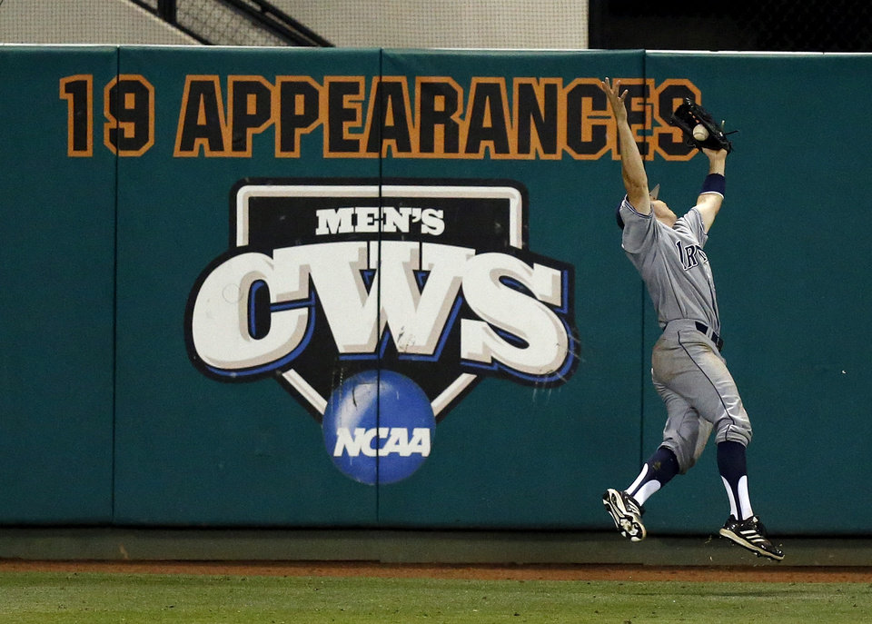 Photo - UC Irvine's Adam Alcantara (30) catches a fly ball in the 6th inning  during Game 1 of the NCAA baseball Stillwater Super Regional between Oklahoma State and UC-Irvine at Allie P. Reynolds Stadium in Stillwater, Okla., Friday, June 6, 2014. Photo by Nate Billings, The Oklahoman