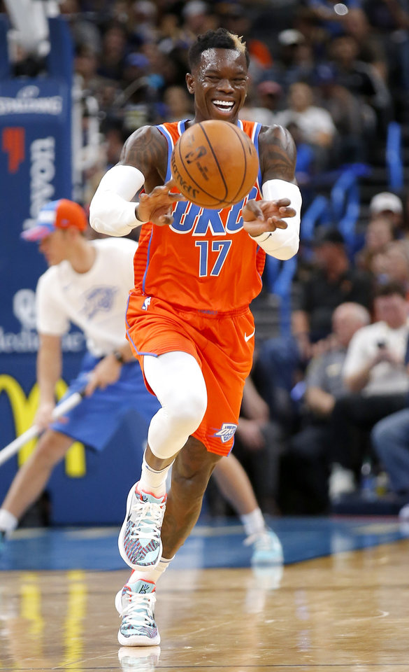 Photo -  Thunder guard Dennis Schroder passes the ball during Sunday's game against Golden State. Schroder led OKC with 22 points, eight rebounds and six assists. [Sarah Phipps/The Oklahoman]