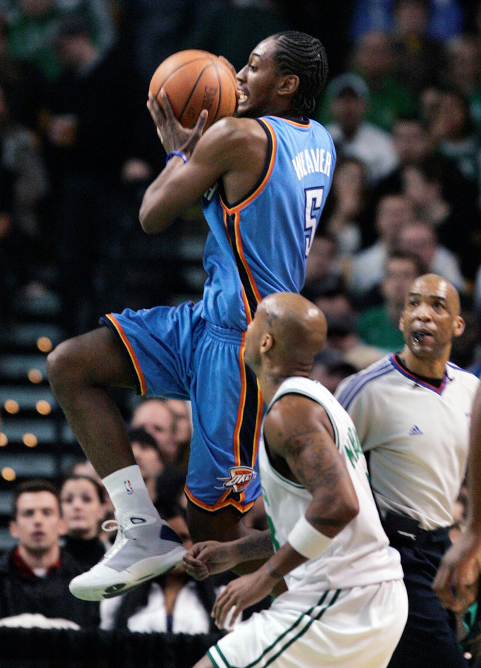 Photo - Oklahoma City Thunder's Kyle Weaver, top, goes up to shoot in front of Boston Celtics' Stephon Marbury in the second quarter of an NBA basketball game, Sunday, March 29, 2009, in Boston. (AP Photo/Michael Dwyer) ORG XMIT: BXG104